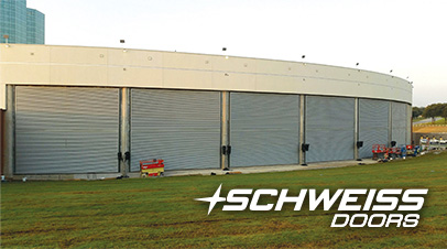music factory's seven schweiss bifol liftstrap doors wrap-around the building's 10.5 degree curve to it