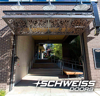 Pike Motorwerks's Schweiss bifold walkway doors/gate openee for Pike Motorworks Apartments Atrium