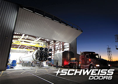 Rocket Hangar has a Schweiss Bifold Door - Nighttime picture