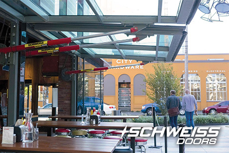 Schweiss Hydraulic Restaurant Doors make a great impression on passerby's by customers
