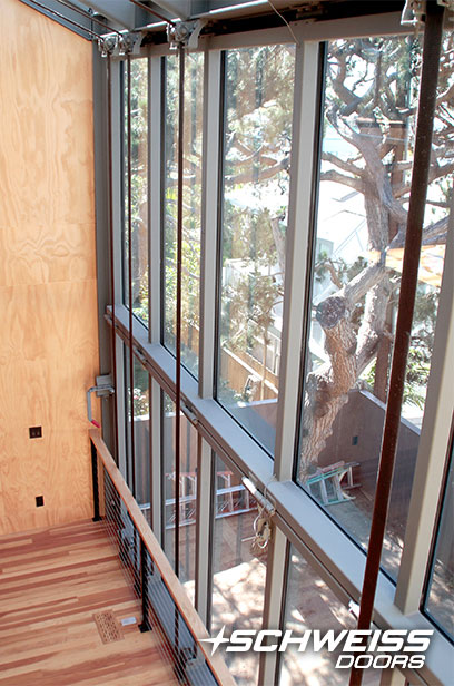 Top-drive bifold designer doors clad with energy-efficient glass