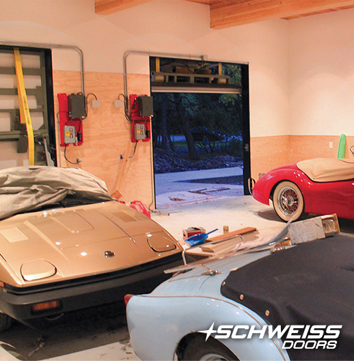 Schweiss Bifold Doors were made to house Struther's collection of old British Cars
