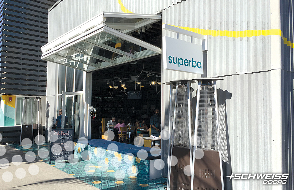 Superba Food + Bread has a Schweiss Bifold Glass Door at the front of the Restaurant