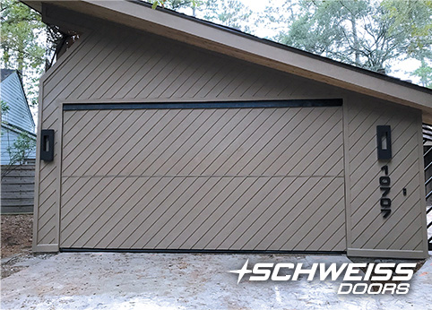 Schweiss Bifold Garage door in texas is closed shut and ready to take on a hurricane