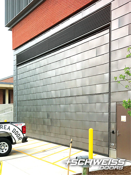 University of Mass schweiss door is clad with Aluminum plank at South college Academic Facility