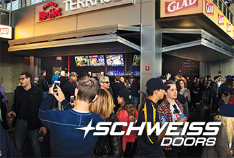 Schweiss Bifold Concession stand Doors are flooded with customers