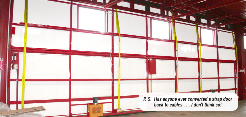 Strap doors do not go back to cables - Schweiss Lift-Strap Door