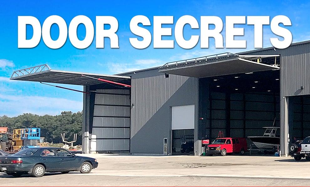 Heavy duty swinging hangar doors