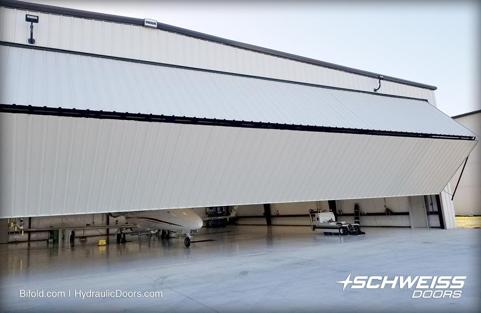 70 foot wide strap lift conversion door gives enough room for Learjet 75 to move in and out of hangar