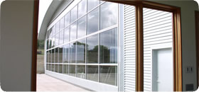 All glass covered bifold hangar door