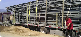 Schweiss Hydraulic doors loaded onto semi