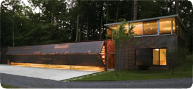 New York lake home with 4 bifold garage doors