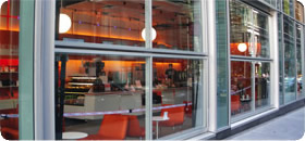 glass bifold doors line exterior of ny restaurant