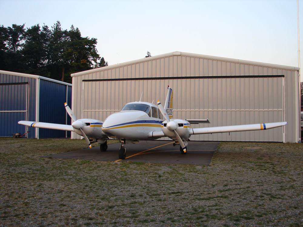 kangaroo copilots the Piper Aztec 6-passenger twin sitting outside of the hangar