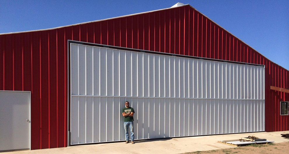 Happy bifold door hangar owner