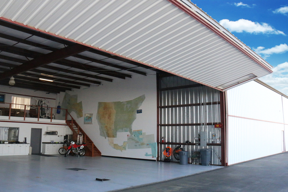 Additional stairway storage was built into this hangar unit.