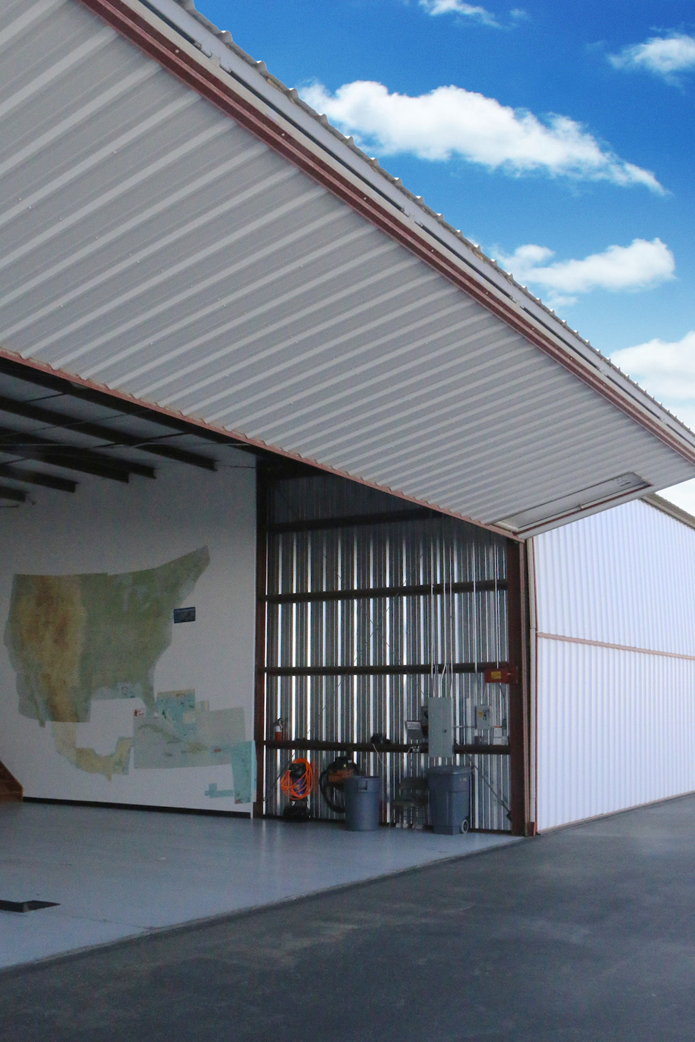A large map is posted on the wall of this hangar for easy pilot and RV owner reference