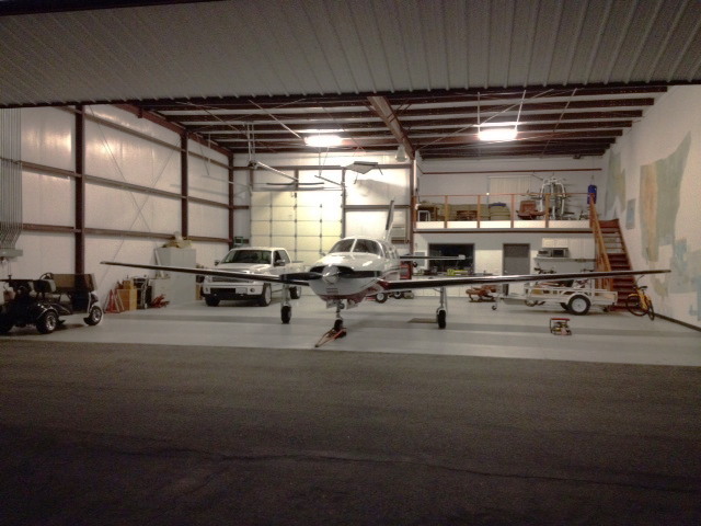 hangar stores a plane, truck, golf cart, and more.