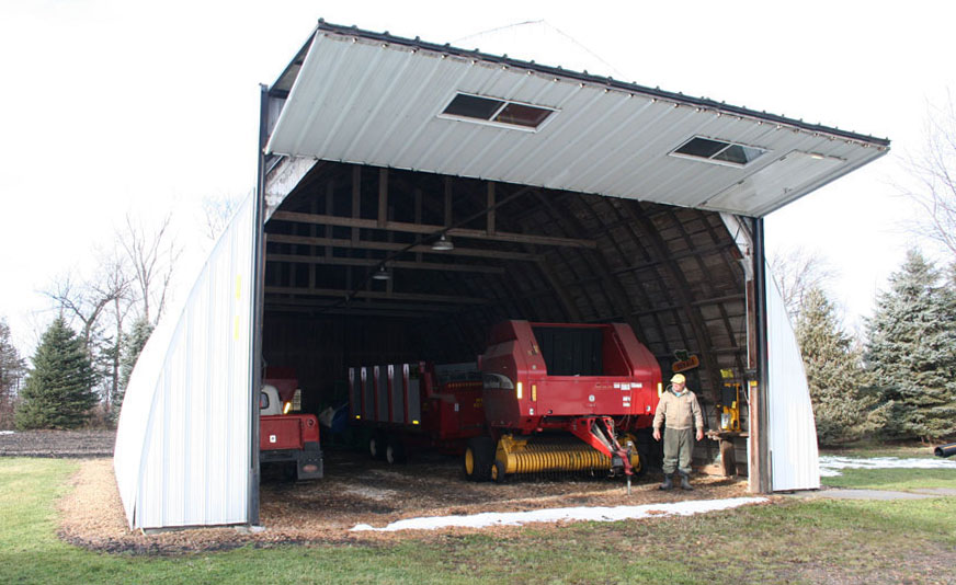 Quonset building with bifold door