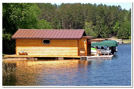 sideview of the new boathouse show the log clad boathouse and schweiss door