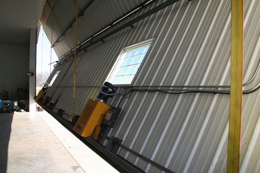 Two strong motors lift and close bifold machine shed door