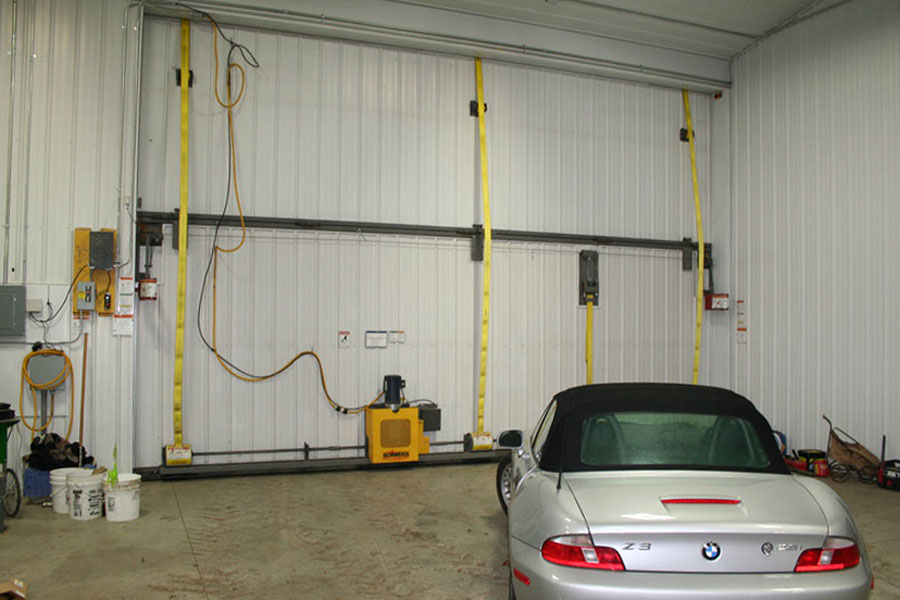 Sidewall bifold door for car storage