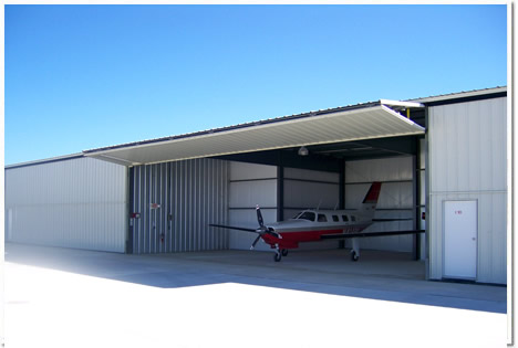 Bifold Door Completely opened with airplane inside of hangar with no lost of head room.