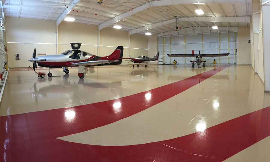 Schweiss Strap Bifold Doors reside on either side of this immaculate  hangar.