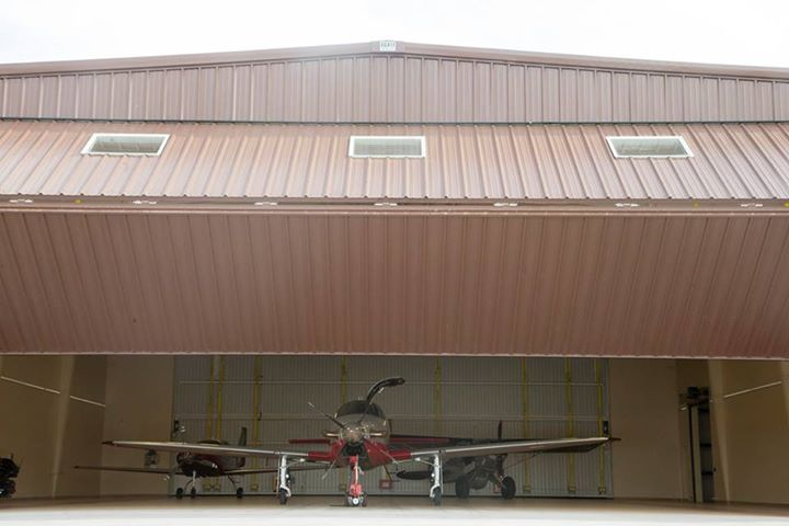 See this 70' x 22' bifold door in action as it shows off three gorgeous aircraft.