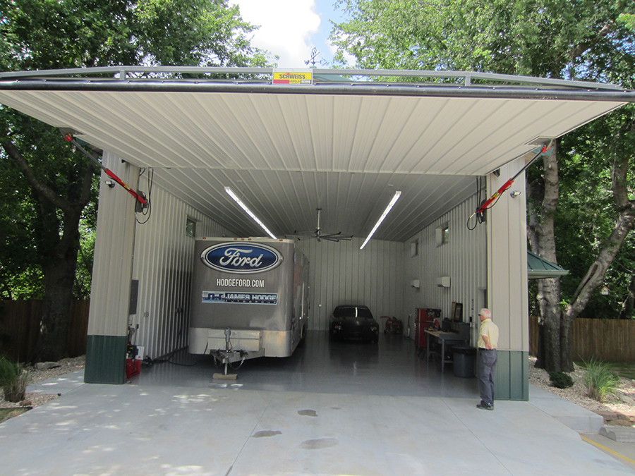 Schweiss hydraulic garage door open showing garage