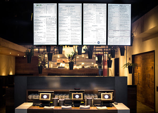 Digital menu board showing a large selection of gourmet meals.