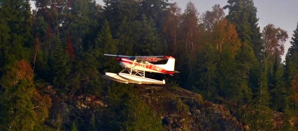 Cessna 185 flying over lake Dryden