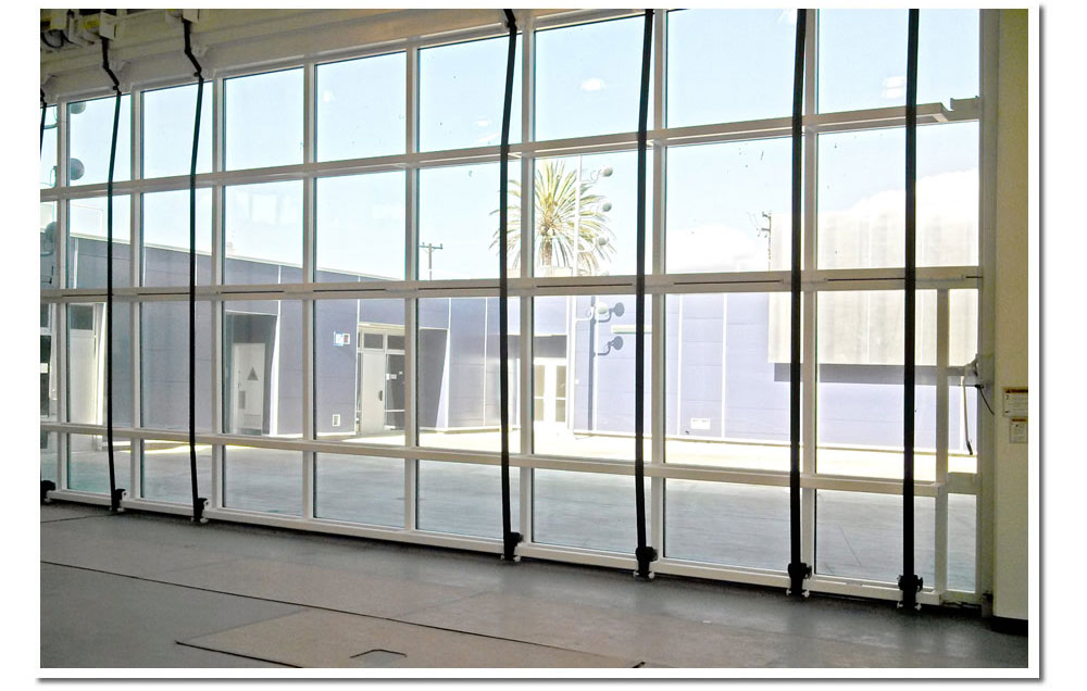 Edison language academy ca installs glass bifold door schweiss eight liftstraps and a top drive electric motor easily open the glass bifold door and will give students a nice view and outdoor access to and from the planetlyrics Gallery