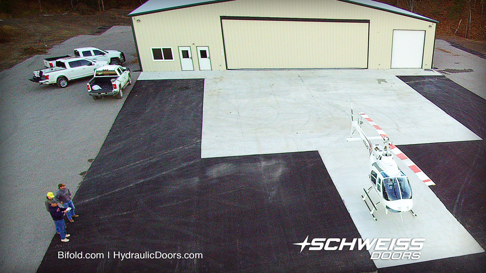 Aerial shot of helicopter and the schweiss hydraulic one-piece door