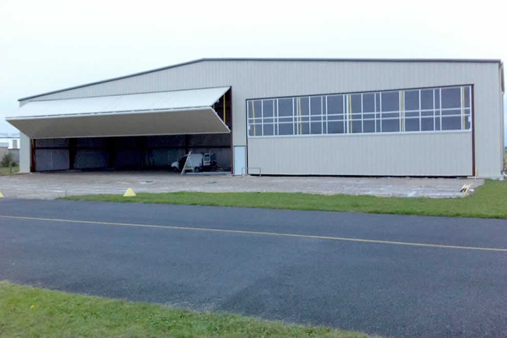 new hangar with two Schweiss Bifold liftstrap doors on it