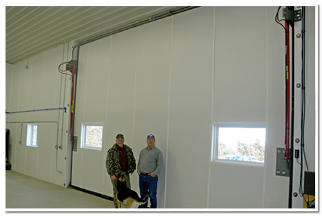 two 24' side hydraulic doors are installed