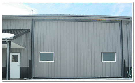24 by 15 ft hydrualic door is a built for racing drag cars