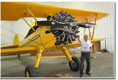 Fuchs stands by the awesome looking engine on his 1942 Stearman PT 13D.