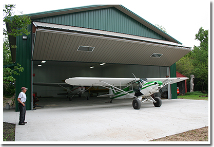 Schweiss Liftstrap bifold door helps Gene get his three planes into his machine shed fast.