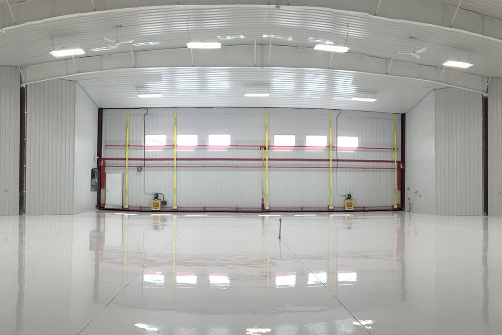 Clean airport hangar doors