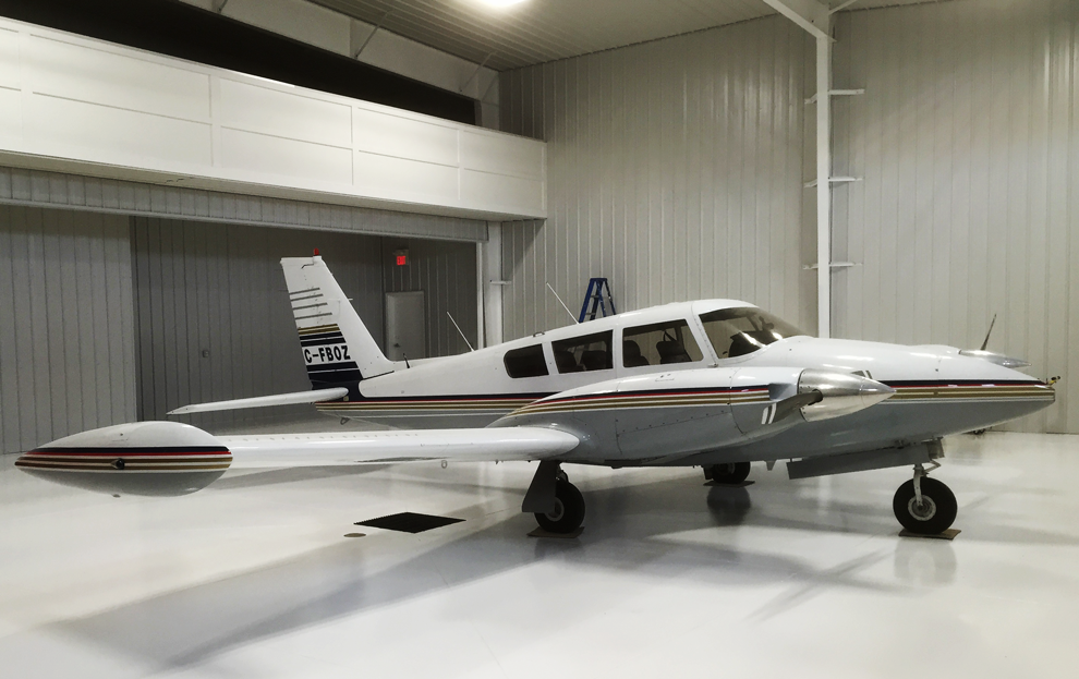 Hangar holding Airplane has Schweiss Doors add ons like walk doors and remote openers