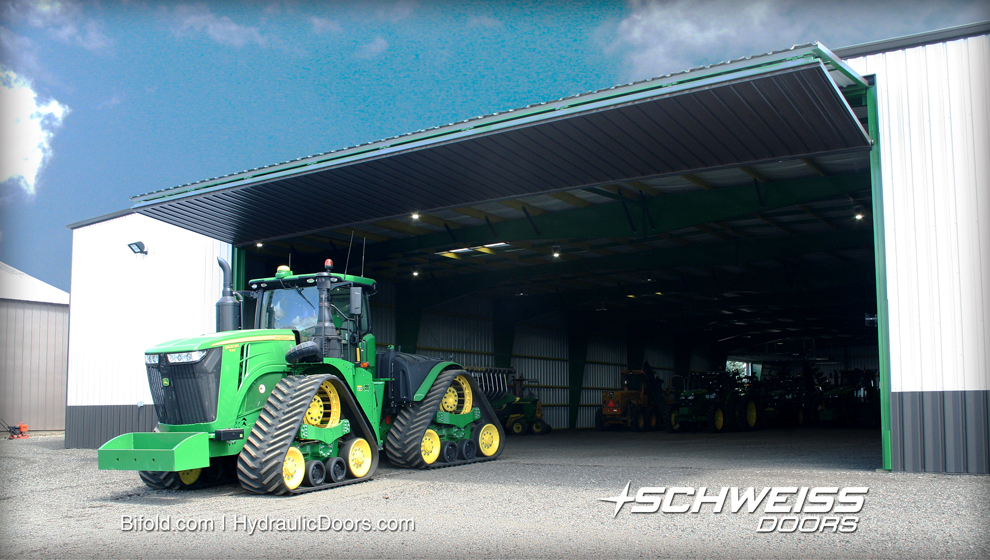 Big Equipment Shed door is wide and tall enough for his largest tractors, and