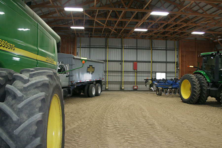 A very wide open machine shed.