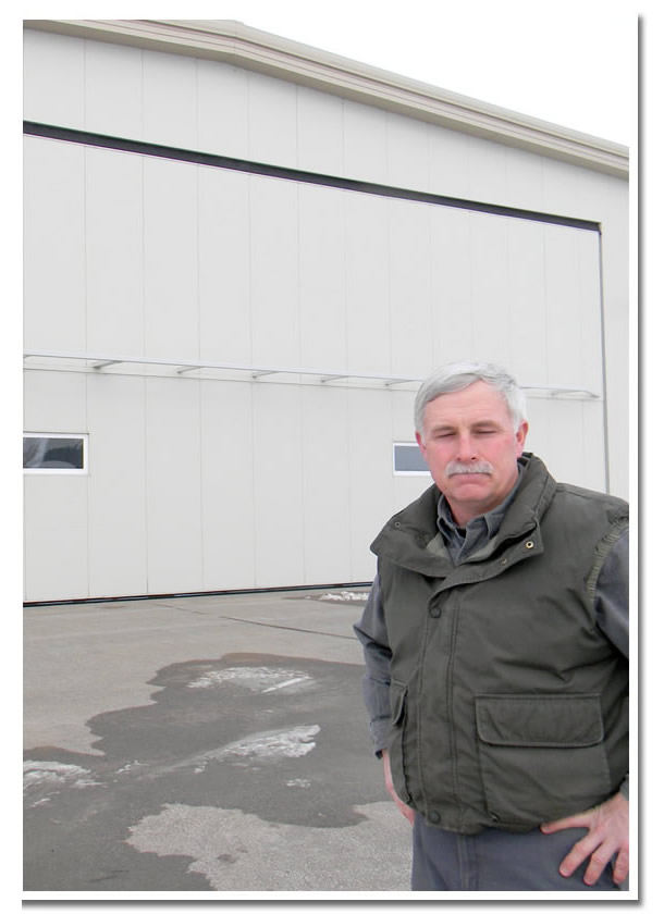 Marty Kiehm in front of hangar and Schweiss Bifold StrapLift Door