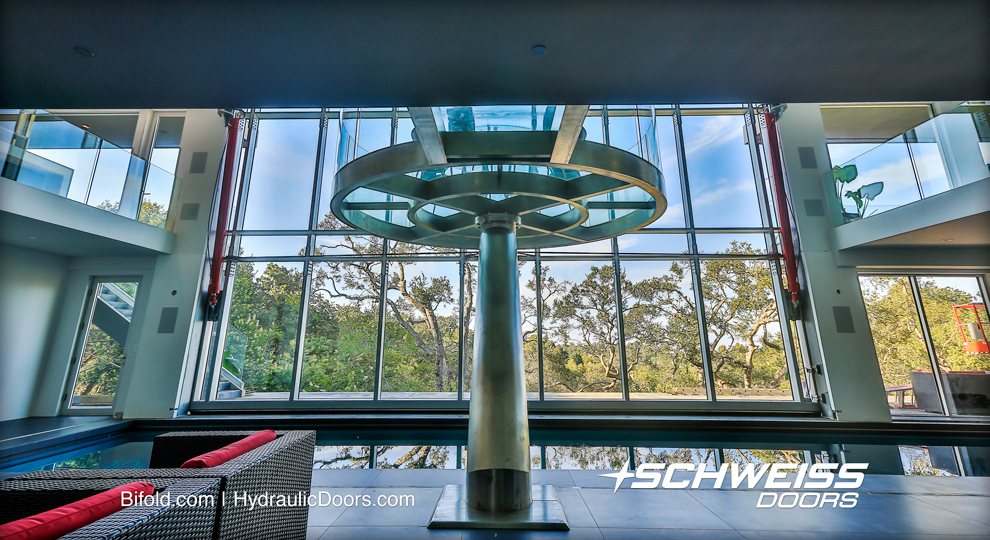 Hydraulic Glass Curtain Wall Door is opened every week or more, and gives a great view from the cantilevered dining table