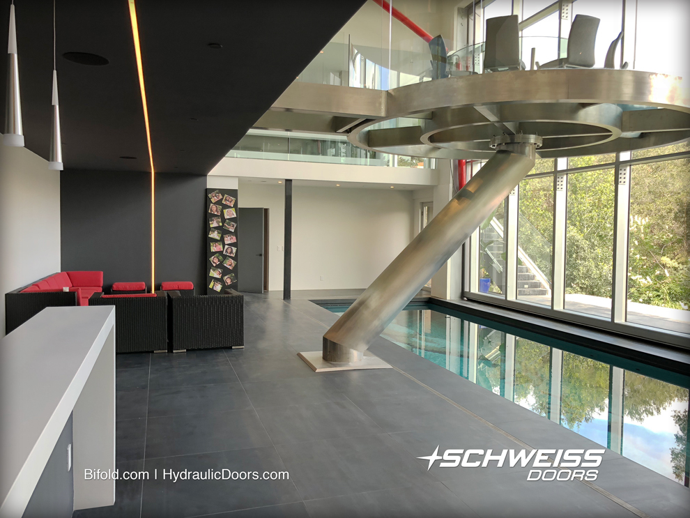 House was designed to have the inside be in the shade all of the time, even with a large Schweiss One-Piece Hydraulic Door