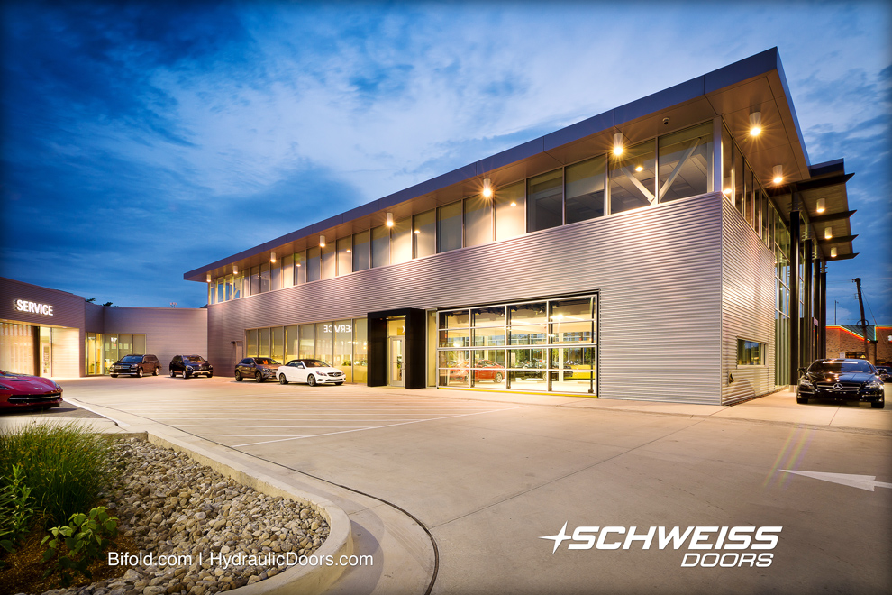 Schweiss Bifold Dealership Doors shows off cars from the outside