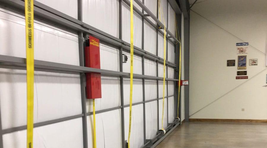 Four Schweiss liftstraps for lifting the Schweiss Bifold Door & Tennessee Turntable - Piper Airpark Hangar | Schweiss Doors