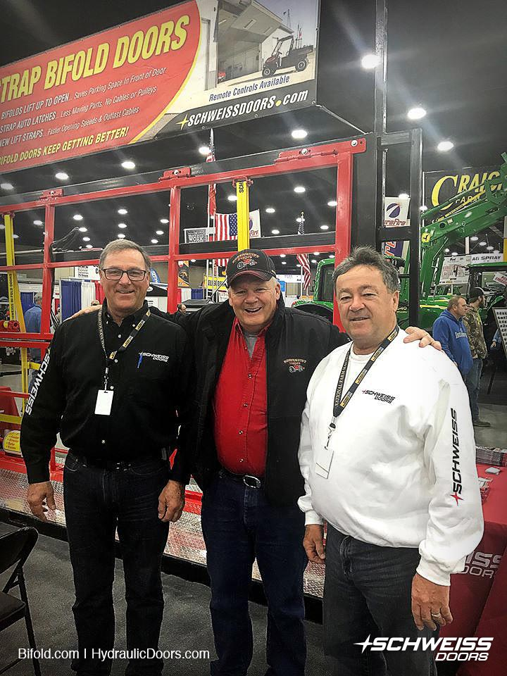 Schweiss Doors Dooth at National Farm Machinery Show is visited by, Rosenquist, owner of five Schweiss Bifold Doors
