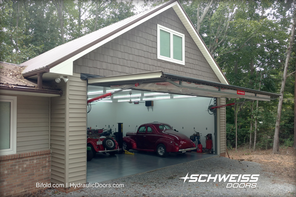 Two-story garage and workshop has a Schweiss 25.4' x 9' hydraulic door